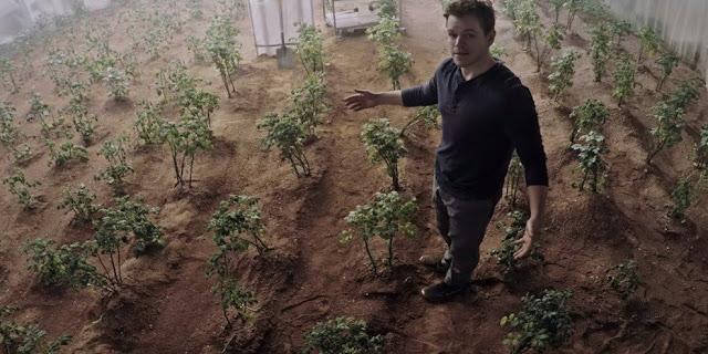 "Matt Damon's character in ""The Martian"" growing plants on Mars. Credit: 20th Century Fox"