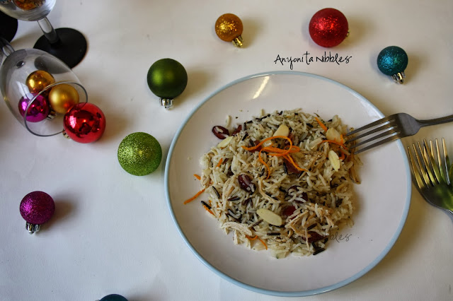 A plate of Boxing Day Jewelled Rice with spilled Christmas baubles from www.anyonita-nibbles.com