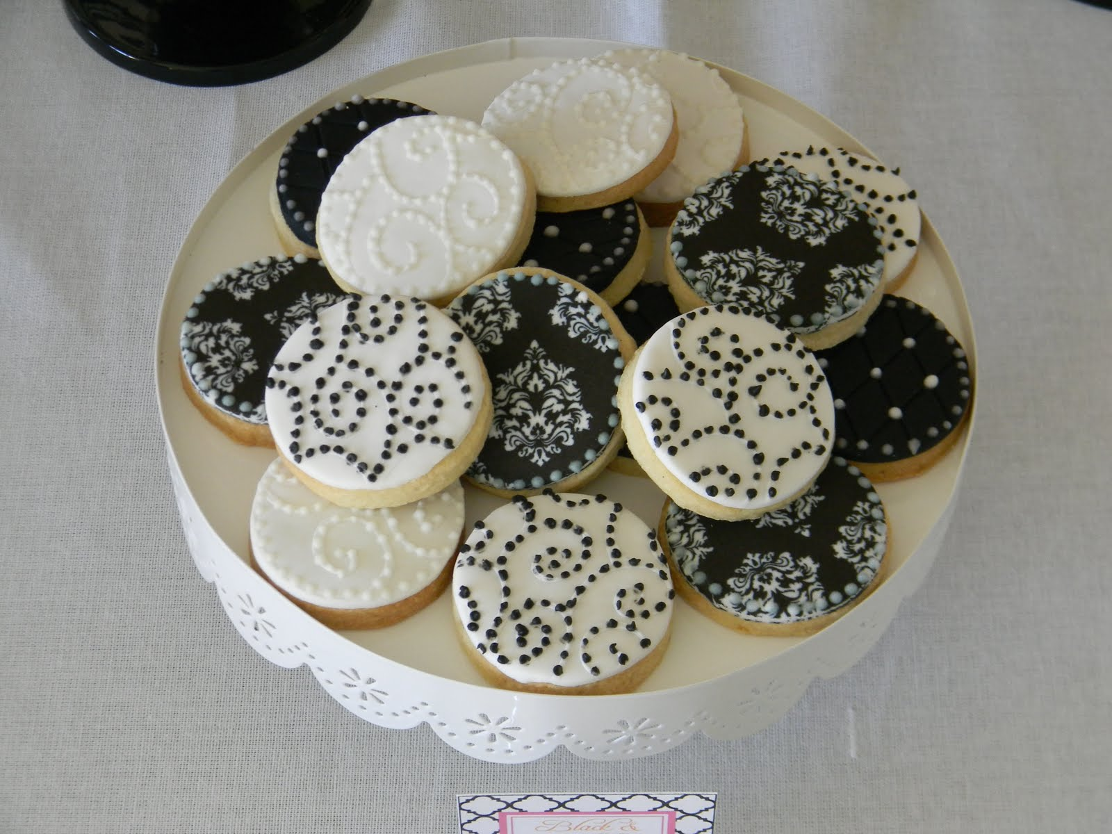 Black and white sugar cookies, some were embossed while others had ...