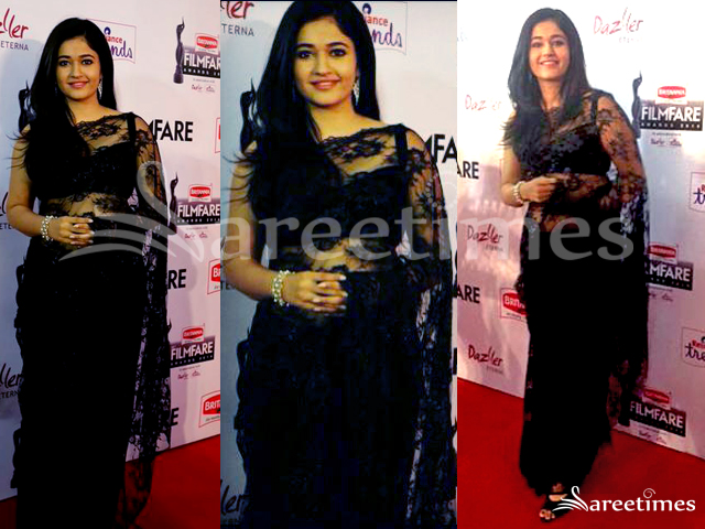 661cd00d Poonam Bajwa at the South Filmfare Awards event in a black lace net saree  paired with a sleeveless black blouse.
