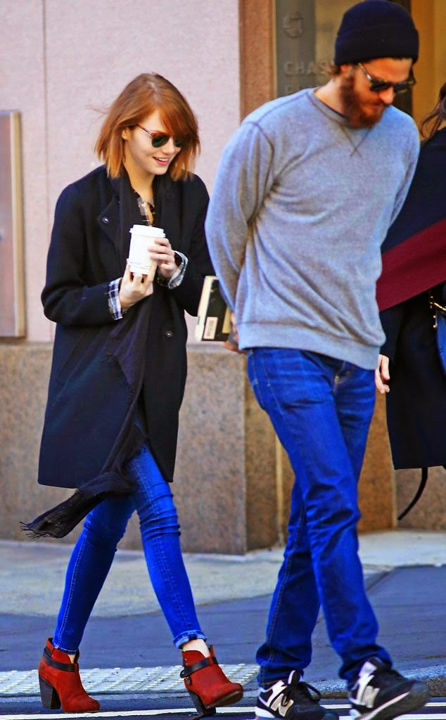 on Saturday, December 27, 2014, Emma Stone made the wise choice to dons a matching blue of coat, clothes with red shirt on inner, Jeans and brown boots.  The 25-year-old was seen strolling so romantically with boyfriend, Andrew Garfield as she holding a coffee cup alongside a shoulder bag.