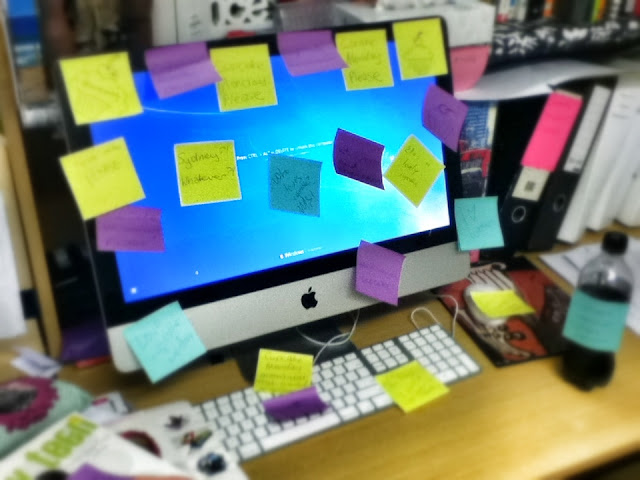 iMac covered in PostIts
