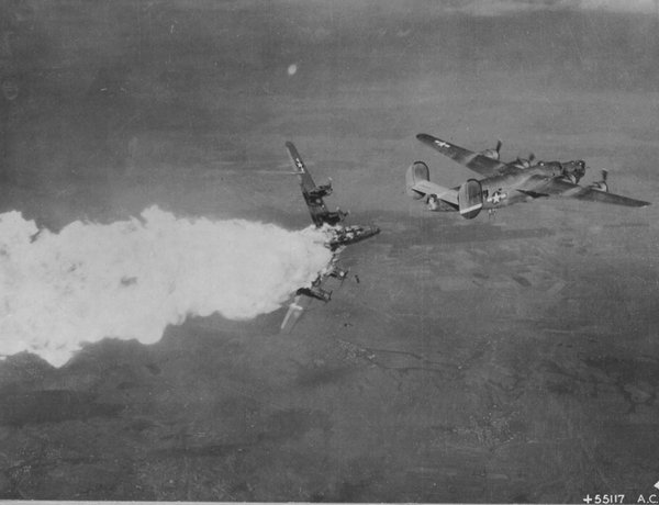 B-24H Liberator bomber exploding in midair after being hit by anti-aircraft fire over Germany, 1944.