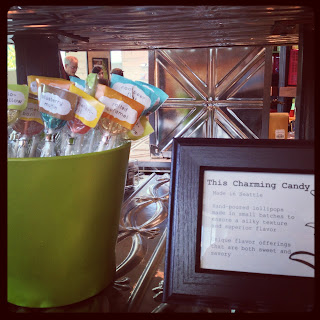 a green bucket of gourmet lollipops at the Chihuly Garden and Glass gift shop