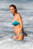 Heather Graham wearing a bikini in the water