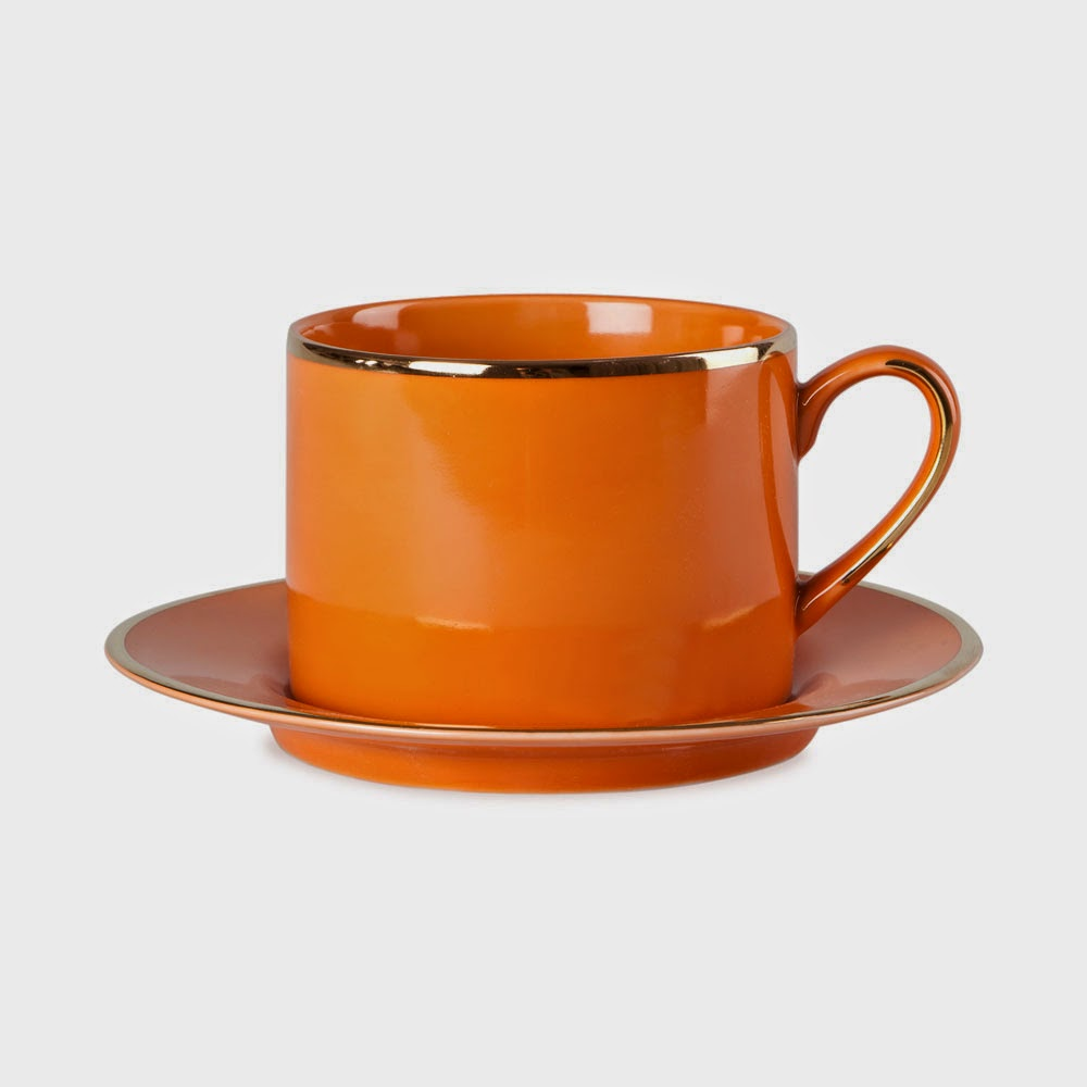 orange and gold teacup