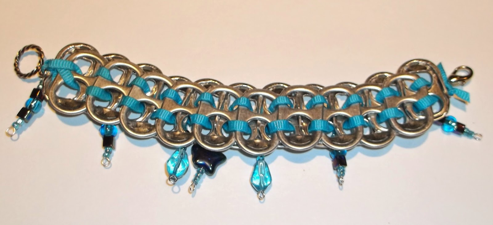 https://www.etsy.com/listing/191651101/upcycled-pop-top-bracelet-with-blue