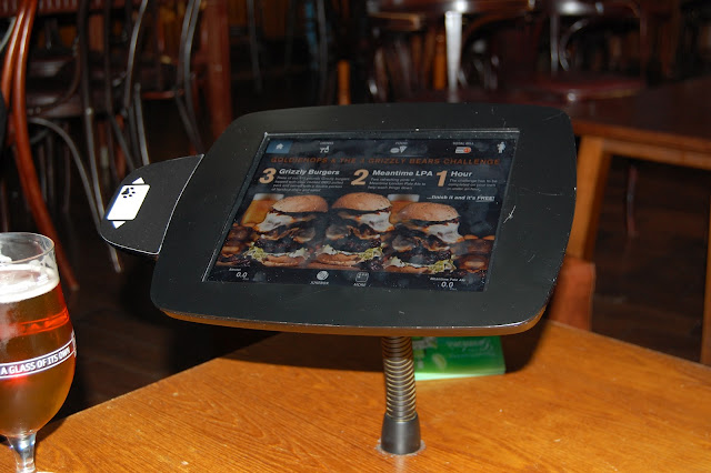 Enjoy a pint of Meantime Pale Ale while you peruse burgers on your inbuilt iPad