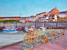 Lobster pots and fishing boats Seahouses