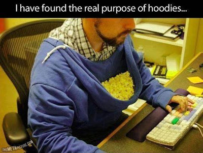I have found the real purpose of hoodies! You wear the hoodie backwards and use the hood to hold popcorn and snacks.