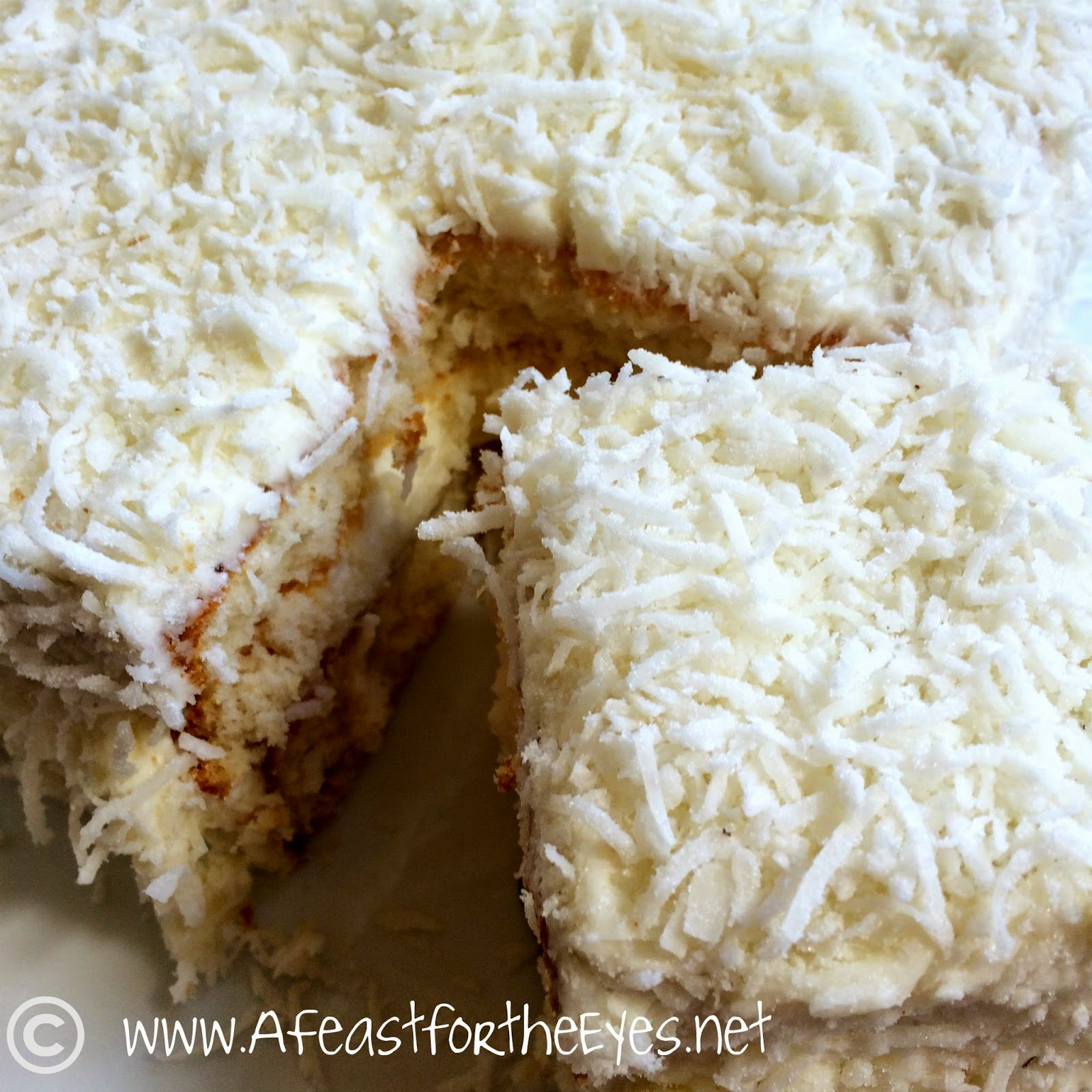 Southern Style Coconut Cake with a Whipped Coconut Cream Cheese Frosting