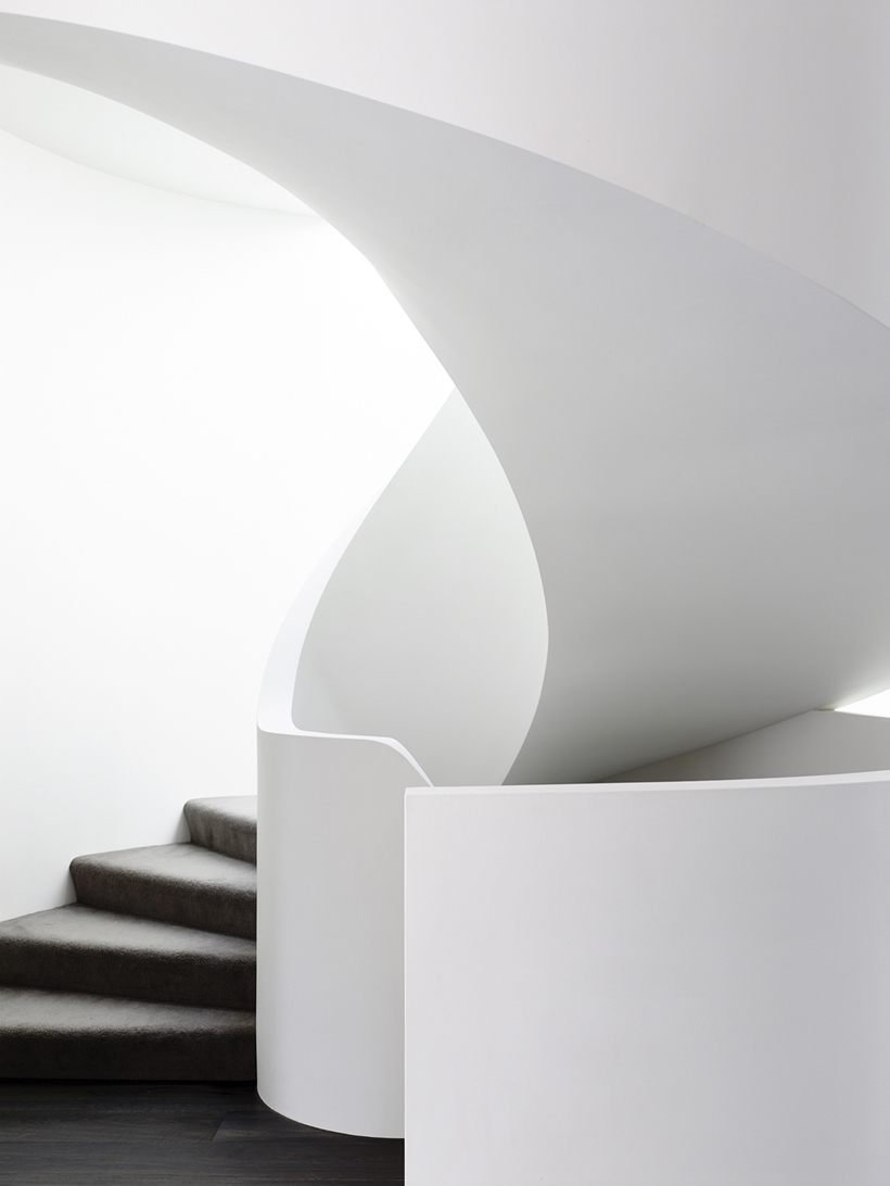 Spiral stairs in Perfect Modern Townhouse by Martin Friedrich Architects