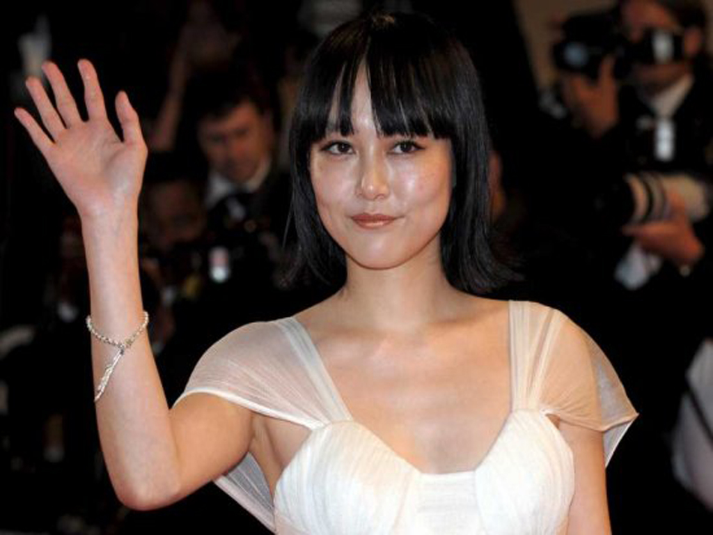 Rinko Kikuchi born Yuriko Kikuchi January 6, 1981, in Warner Bros. Pictures' Pacific Rim (2013)