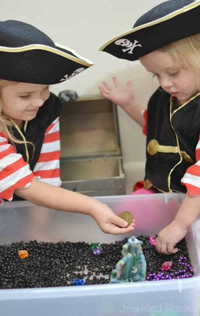 Set up a treasure hunt sensory bin and let the littles spend the morning pretending to be pirates- SO FUN!