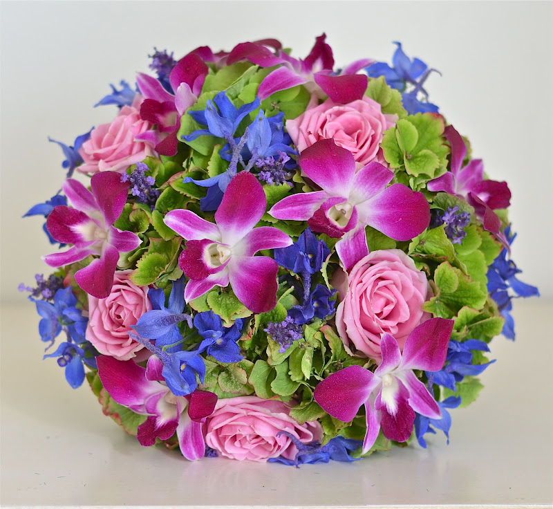 Wedding flowers blog lisa 39 s bright contemporary wedding for Pink and blue flower arrangements