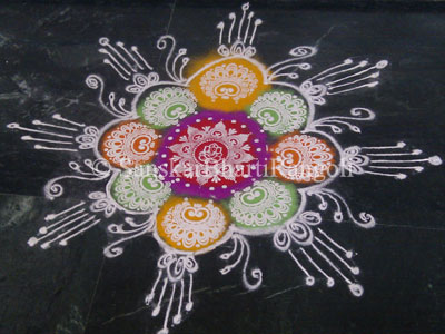 this is a simple and easy rangoli design made using rangoli stencil