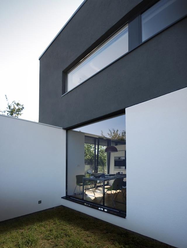 White ground floor and black upper floor terrace