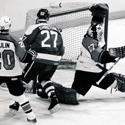 Vs. Philly: Dave Christian watches the puck elude flamboyant Flyer Ron Hextall