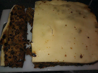 photo of a Christmas cake, brimming with fruit and nuts and a good dollop of brandy, and plety of marzipan atop. Yum!