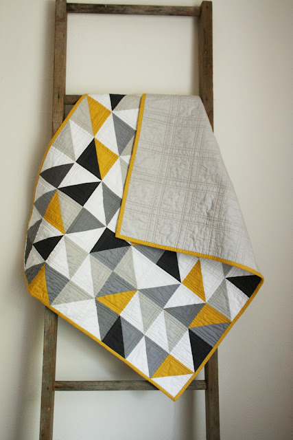 half square triangle block quilt mustard and gray