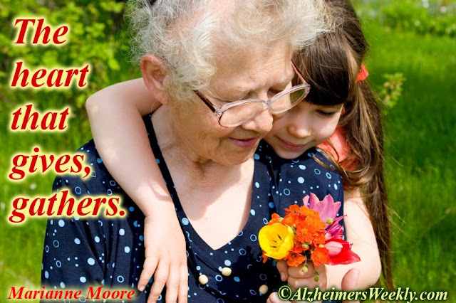 "Saying with photo of grandmother with grandaughter, ""The heart that gives, gathers"""