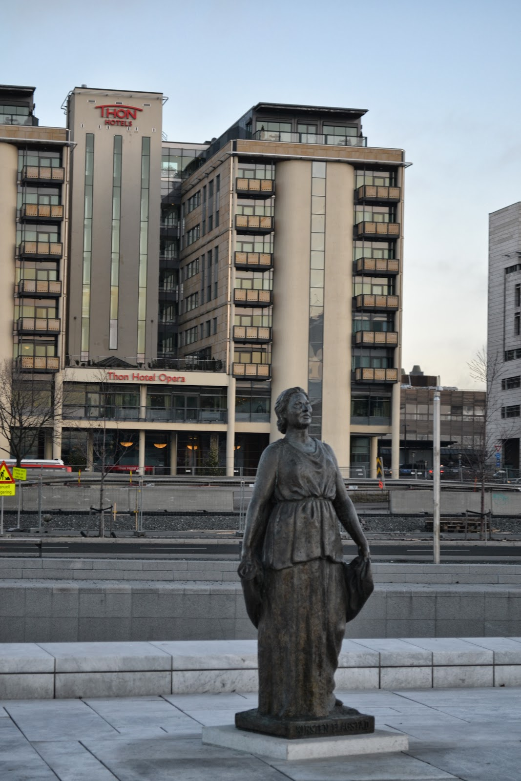 lady singing opera, sculpture near opera house, oslo