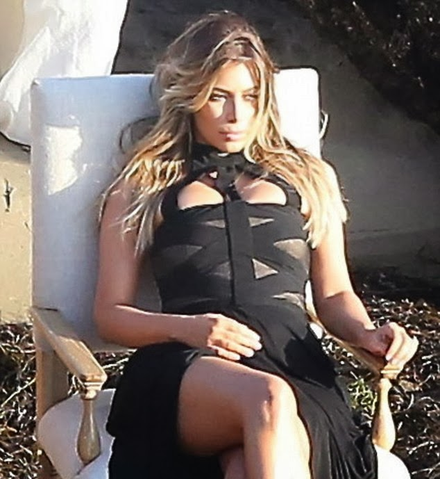Kim Kardashian Looks Beautiful Than Ever in a Revealing Black Dress For Stunning Family Shoot