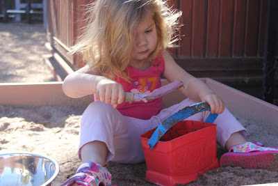 toddler in the sandbox