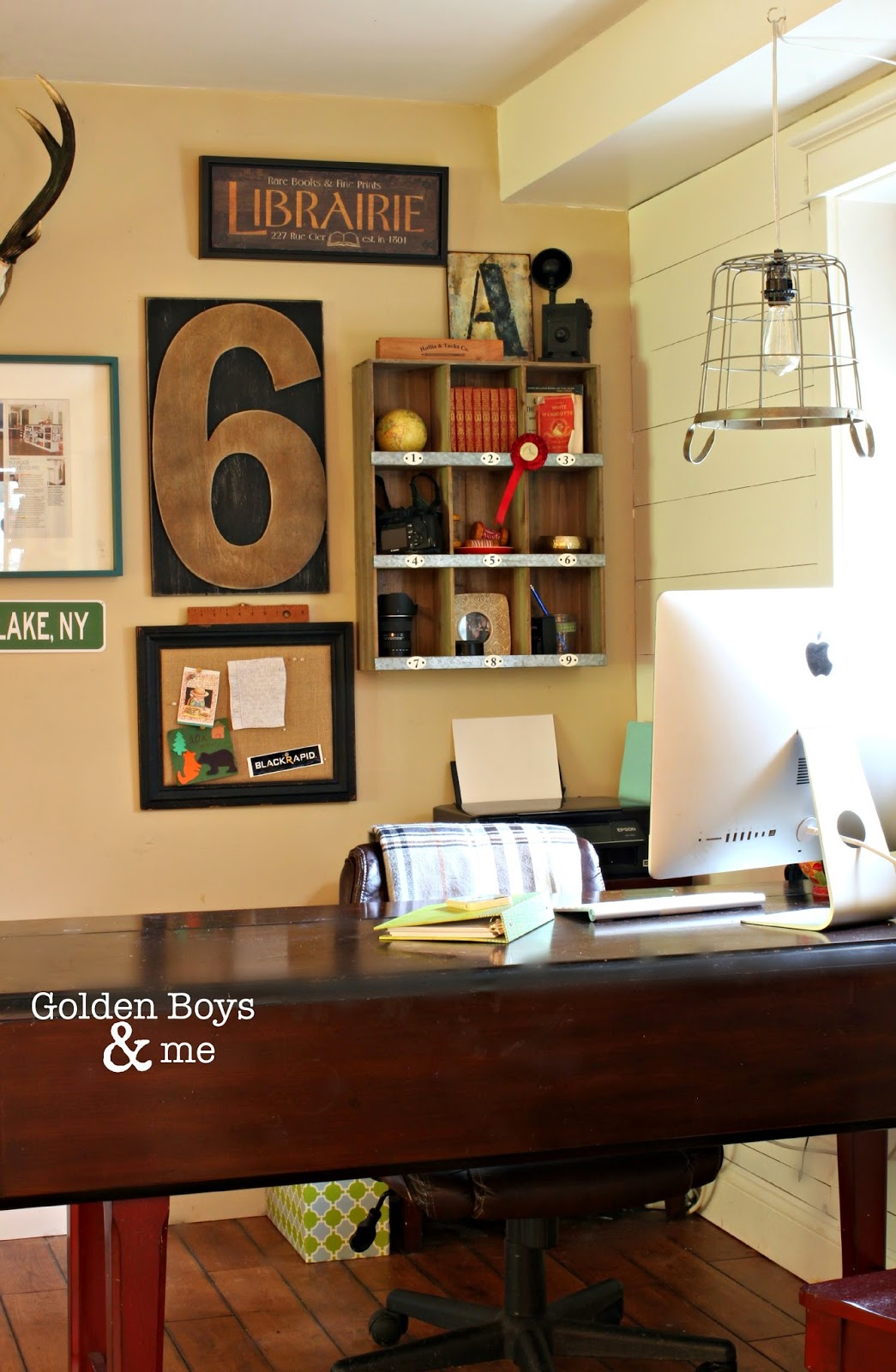 Home office in corner of family room with gallery wall and wire basket pendant light-www.goldenboysandme.com