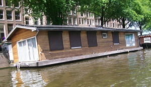 Spend the night on a houseboat at the Canal District in Amsterdam