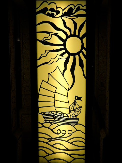 Chinese design of boat and sun silhouette on a lantern in Stanley, Hong Kong