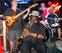 """Clarence plays the Brass Monkey in Marathon  in May 2010 at the Save the Monkey party.  (Photo by Ryan McCarthy, """"Florida Keys Keynoter"""")"""
