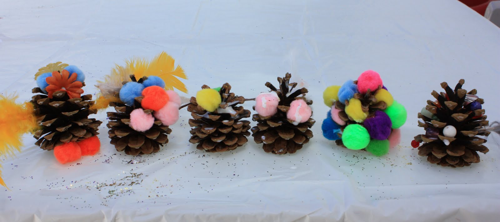 Let kids create pine cone creations for Pine cone art projects