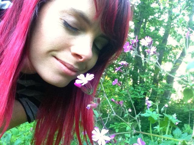 Jennifer Tulip smelling a flower