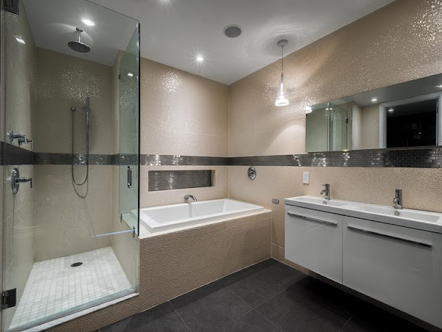 Photo of second modern bathroom with shower cabin and bathtub