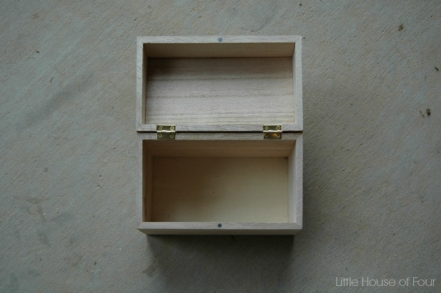 An unfinished wood box gets a major makeover.