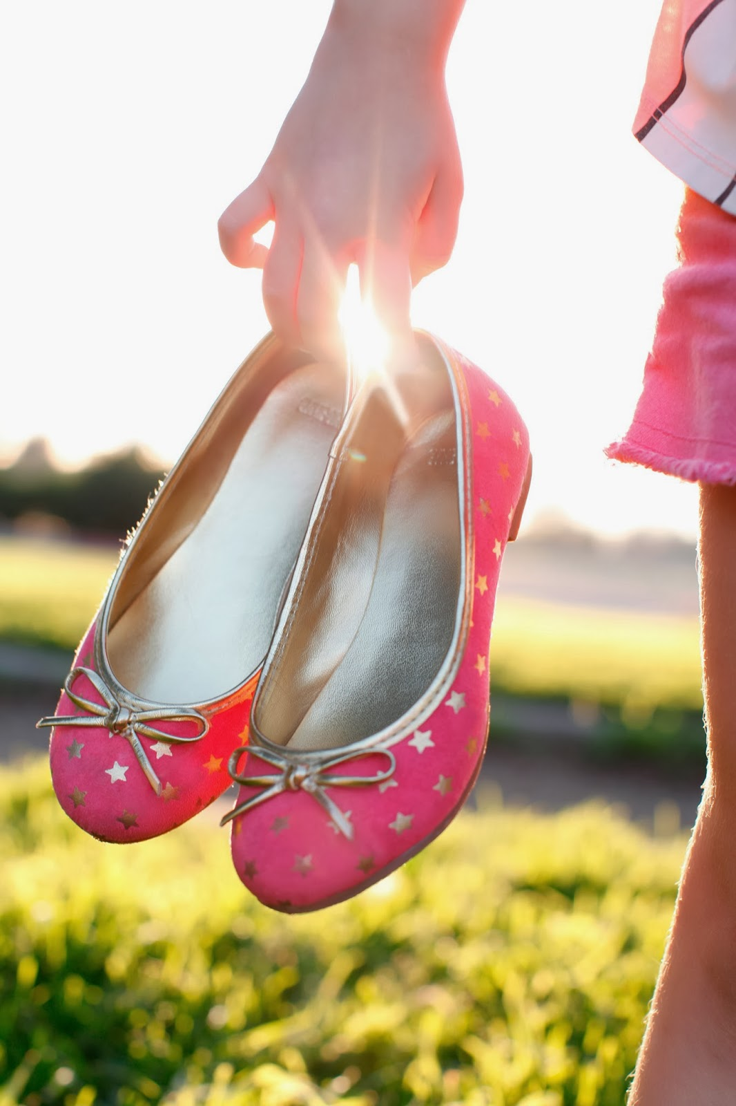 Pink shoes with gold bows