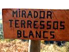 Rètol de fusta indicador del Mirador dels Terressos Blancs