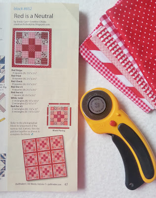 Photo of a magazine page featuring a quilt block and red fabrics