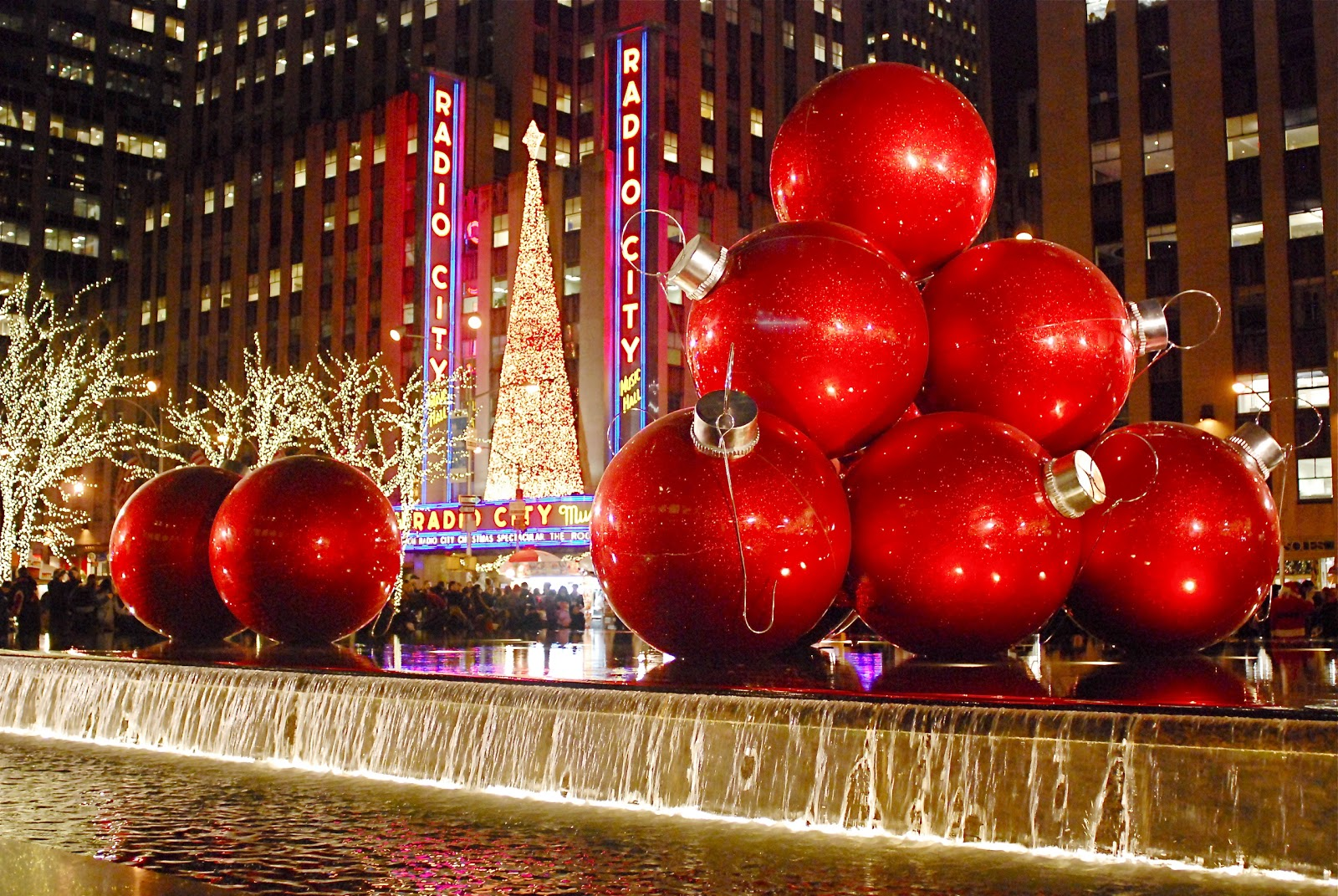 one of the most photographed holiday decorations on sixth avenue are the giant christmas ornaments in front of 1251 sixth avenue building exxon building