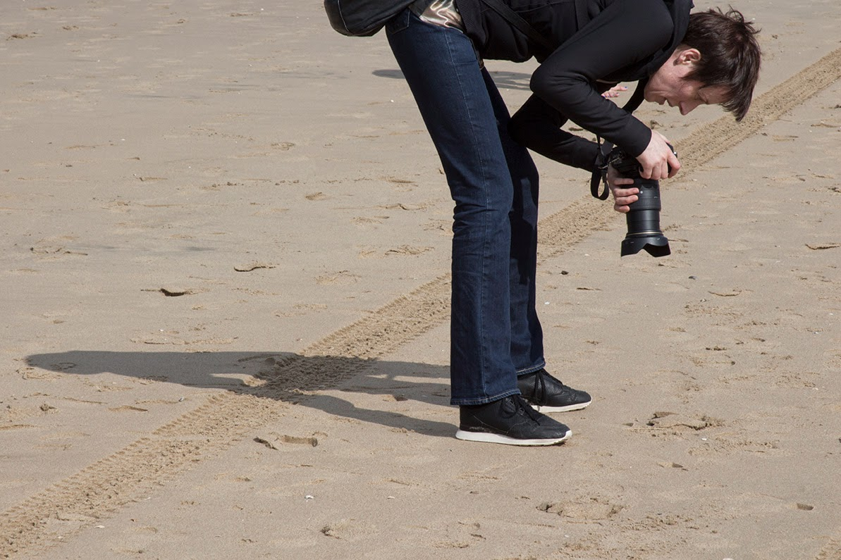 participant taking picture of sand