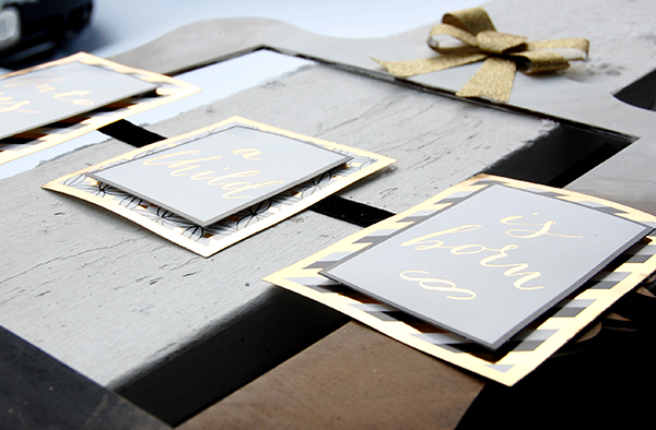 wood frame, gold ribbon, gold, black, white card design upclose