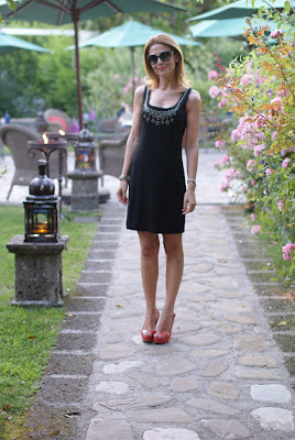 elegant black dress, coral pumps