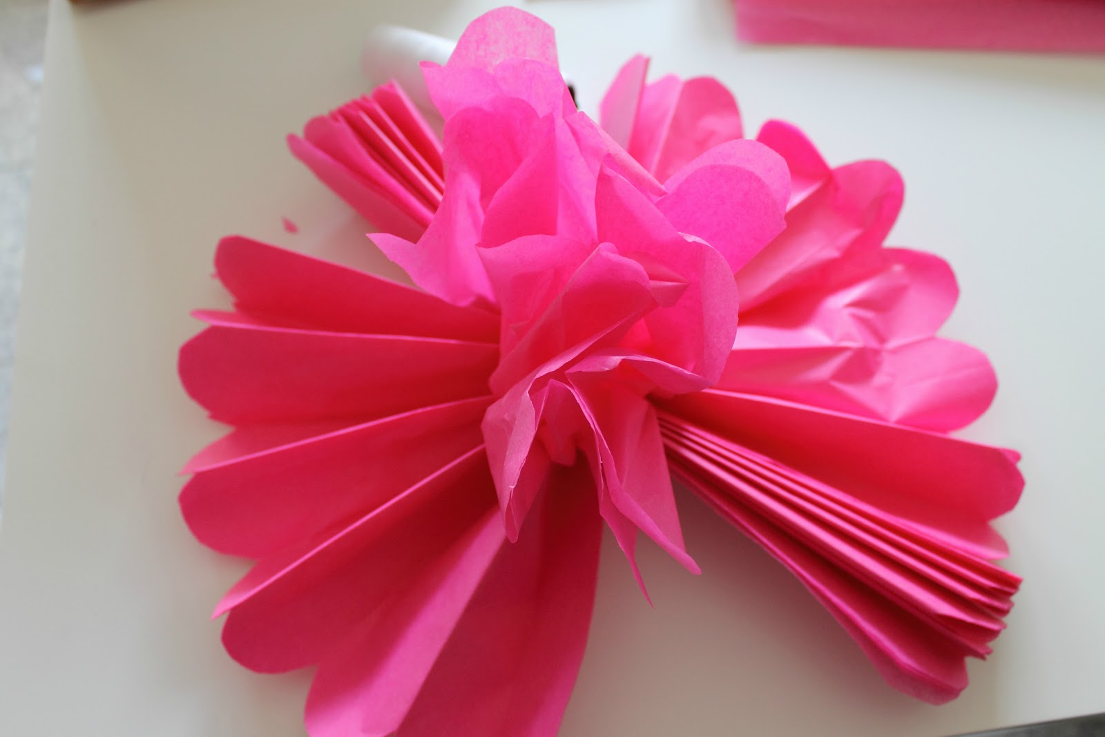 how to make pom poms from tissue paper Tissue paper pom poms have become all the rage, whether they're for parties, home decor, or even weddings they look great, they're cheaper than going out and buying decorations, but best of all they're very easy to make at home.
