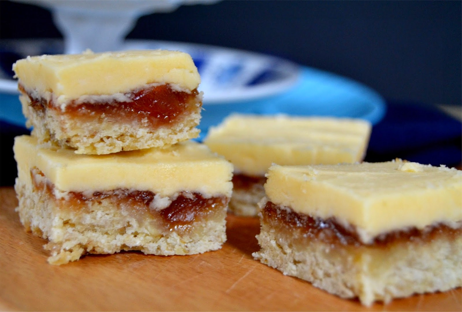 cookie bars topped with rhubarb jam and a custard flavoured icing