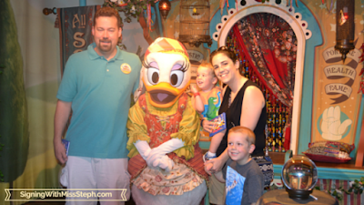 Family standing with circus performer Daisy Duck