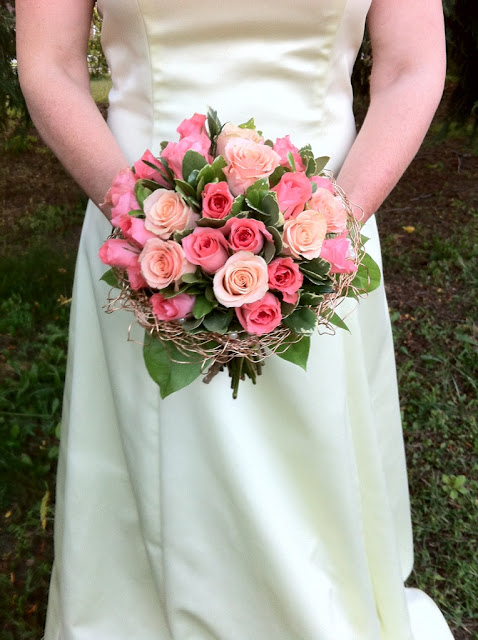 Coral and peach rose bridal bouquet by Stein Your Florist Co.