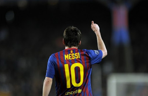 Barcelona forward Lionel Messi celebrates after scoring his second penalty against AC Milan
