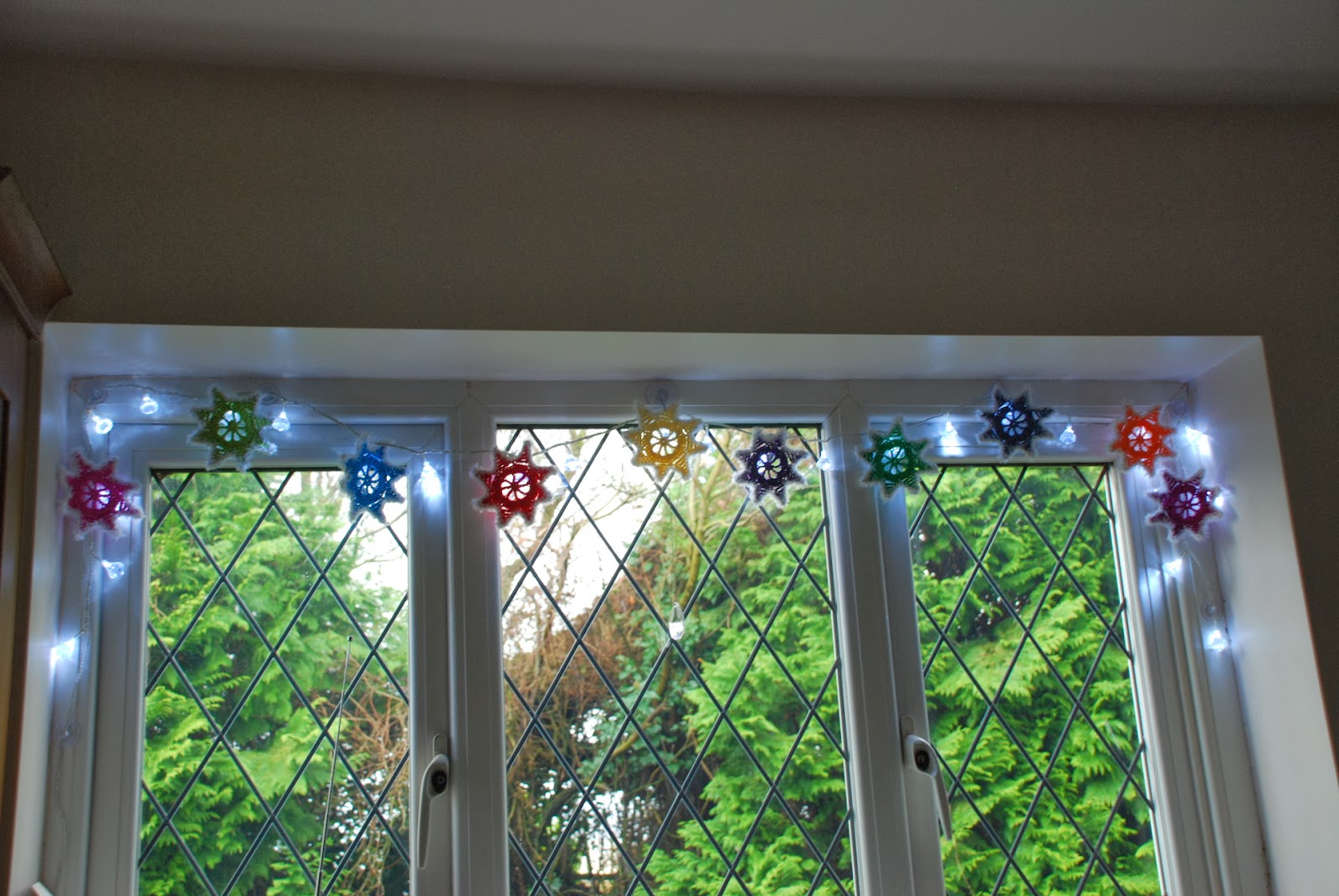 image of fairy lights and colourful crocheted stars for a Winter Garland