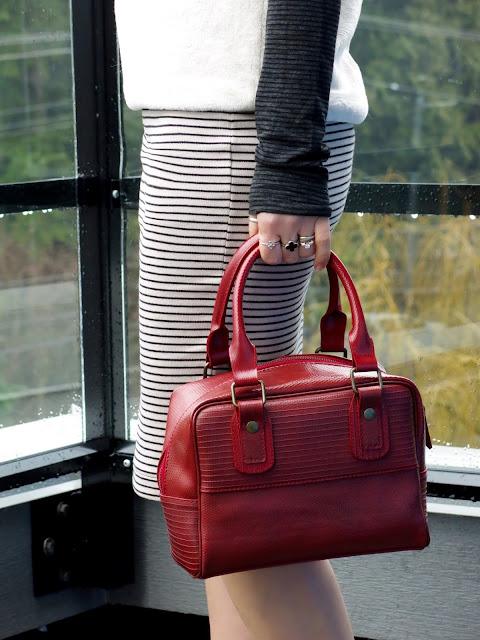 turtleneck, plush tee, striped pencil skirt, and Elvis & Kresse box bag